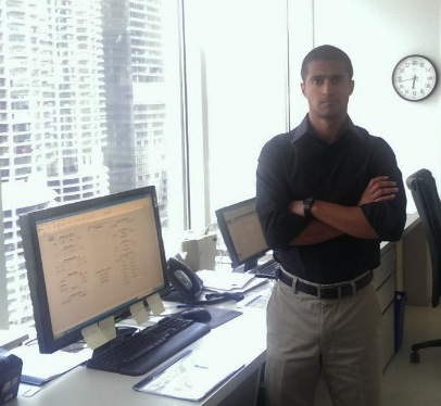 EDF Climate Corps fellow Karan Gupta in front of the Building Automation System at 77 West Wacker