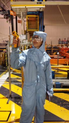 Amy Chiang, an EDF Climate Corps fellow from the University of Michigan, gathers temperature readings from the paint shop during an energy treasure hunt at GM's Silao Complex in Mexico.